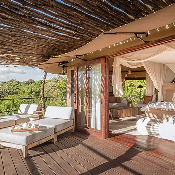 Open the stacking doors onto your private deck and welcome in the warm Tanzania sun into your Mwiba Lodge suite