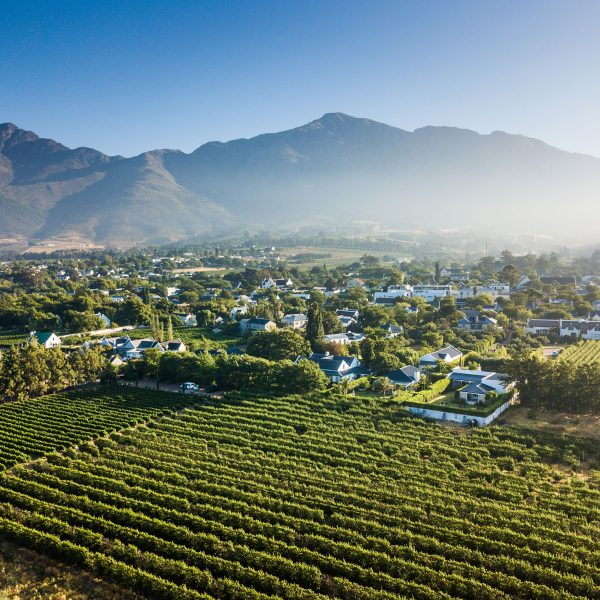 Aerial view over La Clé village bordered by vineyards and surrounded by mountains