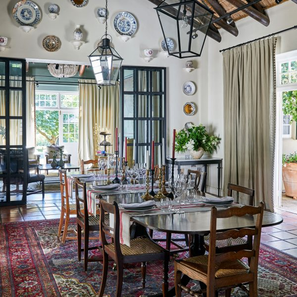 A dining room with intricate details, featuring a dinner table set for 8 people