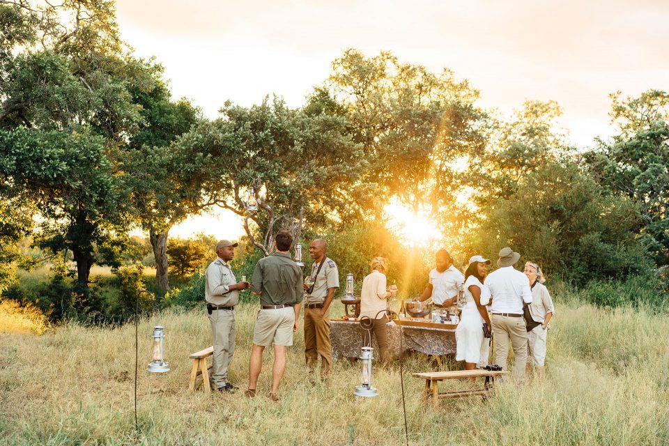 Guests enjoying sundowners at Tanda Tula