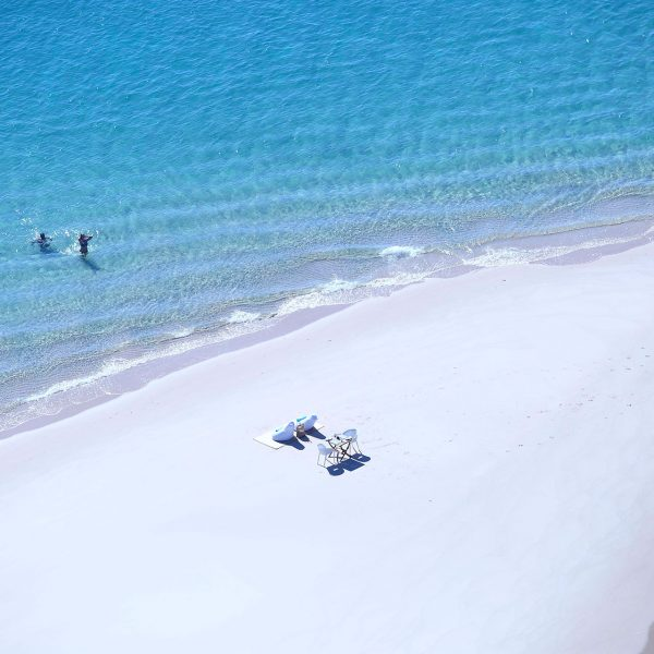 2 guests on a private stretch of beach all on their own