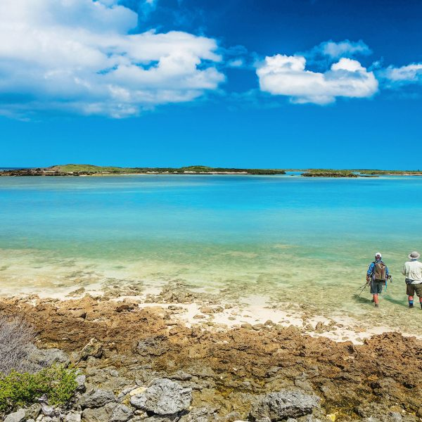 2 guests fly fishing while staying at Astove Atoll