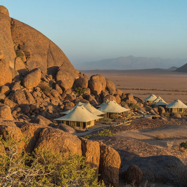 Aerial view over the tented rooms set up against the boulders