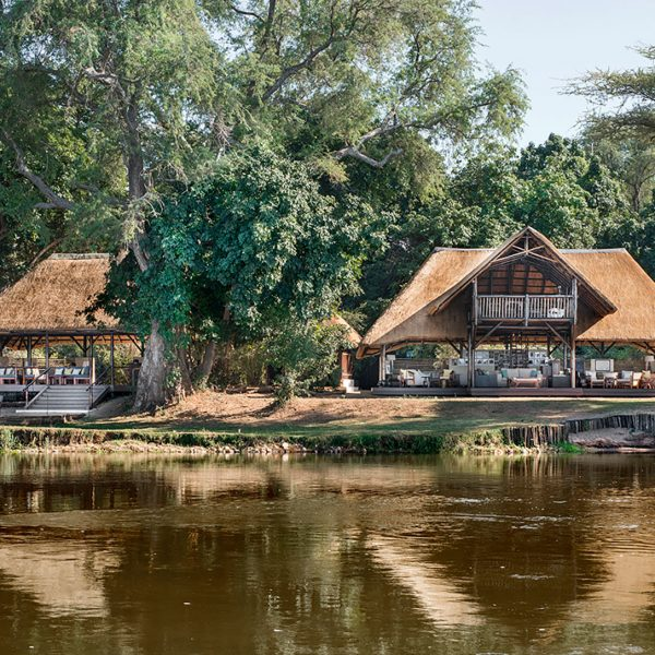 A front view of Chiawa Camp's main area, boma, and boat dock