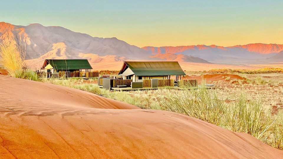 Exterior view of the new Dune Camp against the red sand dunes