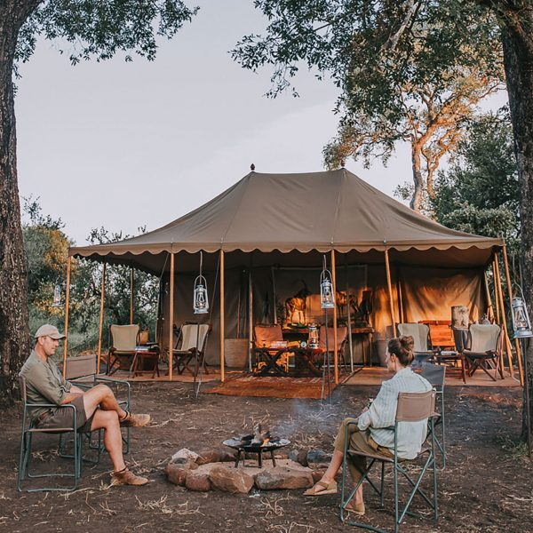 Relaxing around the fire at the main mess tent at Tanda Tula Field Camp