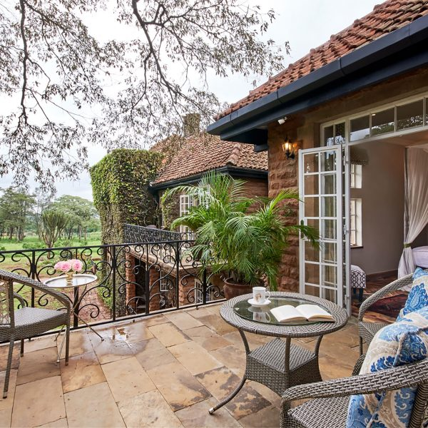 The outdoor patio of the Karen Blixen Suite with chairs and a view