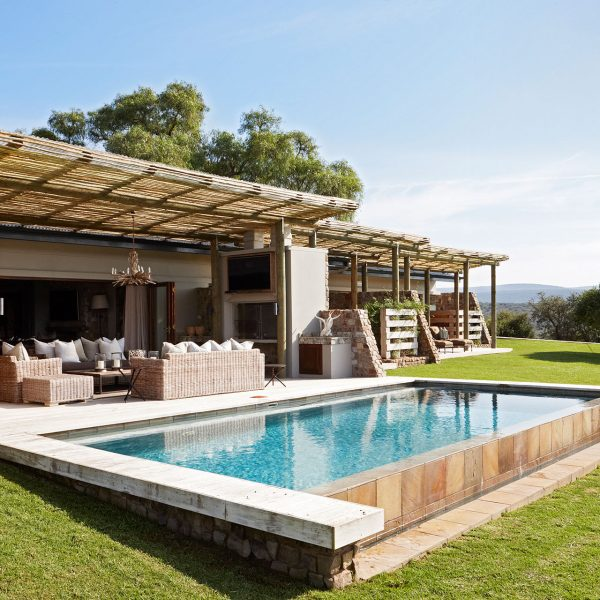 The outdoor living space and pool
