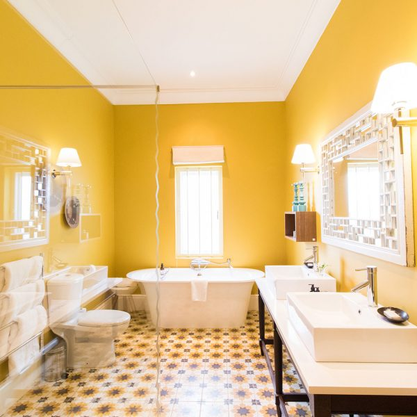 The colorful yellow bathroom in a Domain room