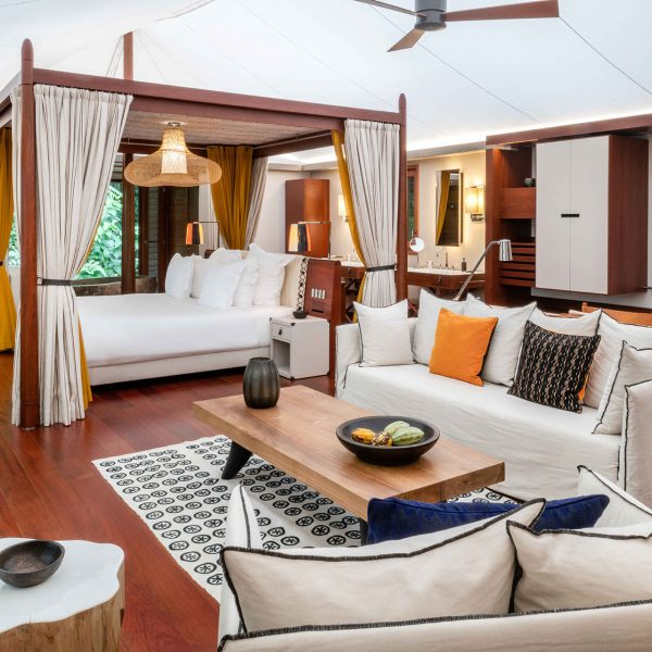 The interior of the villas with a large 4-poster bed and sitting area